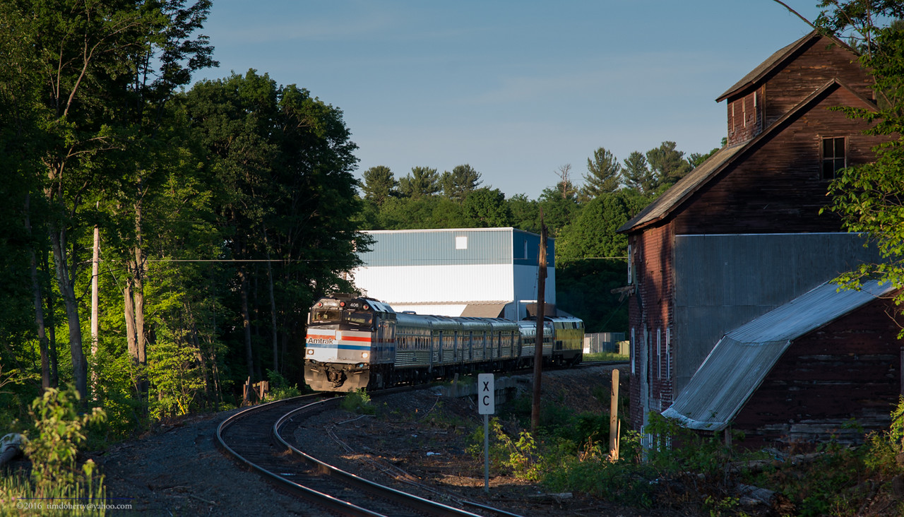 The Amtrak Exhibit Train heads over the Fall River Bridge in Bernardson on the Conn River Line.