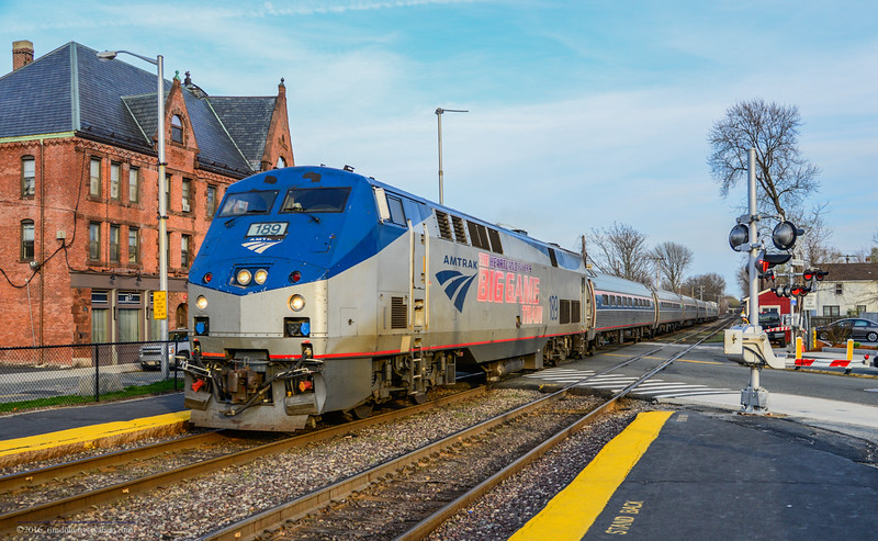The Big Game engine with the Downeaster in West Medford on the Lowell Line.