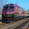MBTA 2027 passing through the platforms at West Medford on the Lowell Line.
