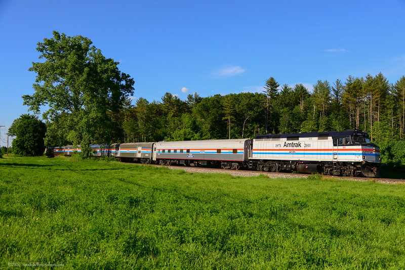 The Amtrak Exhibit Train heads south through Charlestown New Hampshire after spending the day Claremont Station.