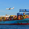 Japan Airlines fight 8 arrives in Boston and passes over the containership MSC Kingston at Conley Terminal.