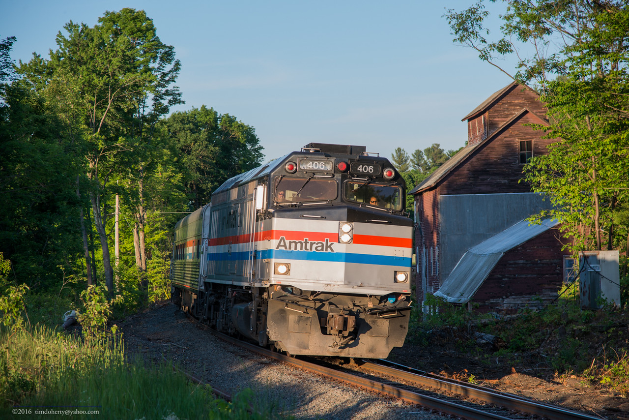 Amtrak 406 passes the Bernardson Feed Mill on the Conn River Line,