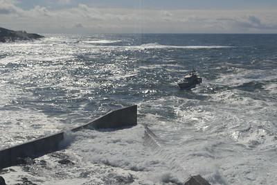 Coast Guard boats coming into the harbor