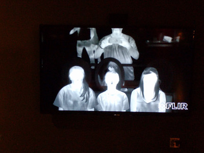 Trip to the Exploratorium. This is infrared imaging showing who's hot (the three girls) and who's cool (the dude in back)