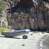 Landing on the beach at Honeymoon Cove. Dinghy wheels saved us a lot of grief in dinghy landings.