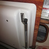 Gas spring holds the fridge lid open and assists in opening what would otherwise be a pretty heavy lid.