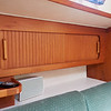 Storage above the port side settee