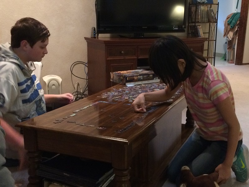 Working on a puzzle at Aunt Kathy's