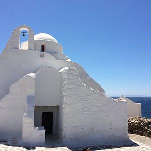 White beautiful castle overlooking ocean - Erin Metro