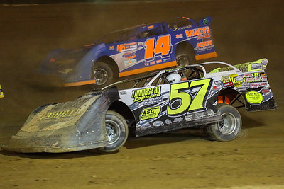 Kyle Thomas (57) and Corey Conley (14)