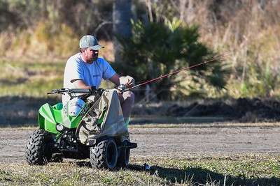 Jonathan Davenport fishing in the Gator Pond in the Volusia Speedway Park pit area
