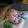 But, exploring is tough.  He fell asleep while he was reading a book.
