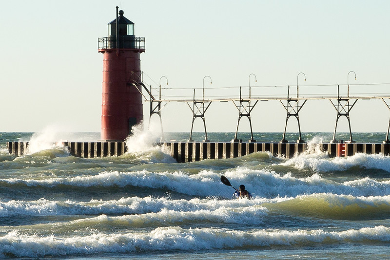 KAYAKER CHALLENGING THE WAVES, SOUTH HAVEN