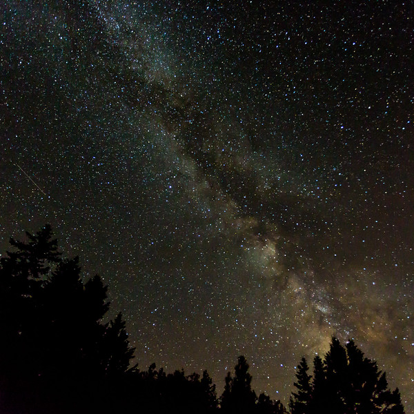 MILKY WAY AND A SATELLITE TRAIL CENTER  LEFT