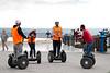 Plaza Balcón de Europa in 29780 Nerja - Kipsta - Touristen fahren auf dem Einpersonen - Transportmittel Segway