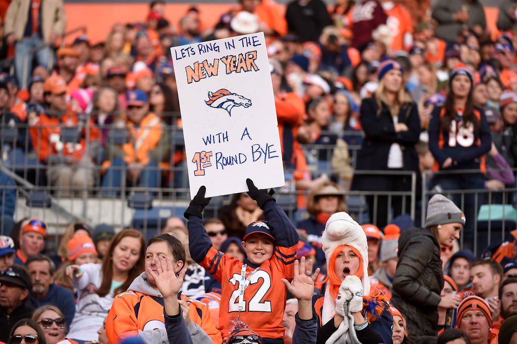 . Denver Broncos fan holds up his sign high during their game against the San Diego Chargers January 3, 2016 at Sports Authority Field at Mile High Stadium. (Photo By John Leyba/The Denver Post)