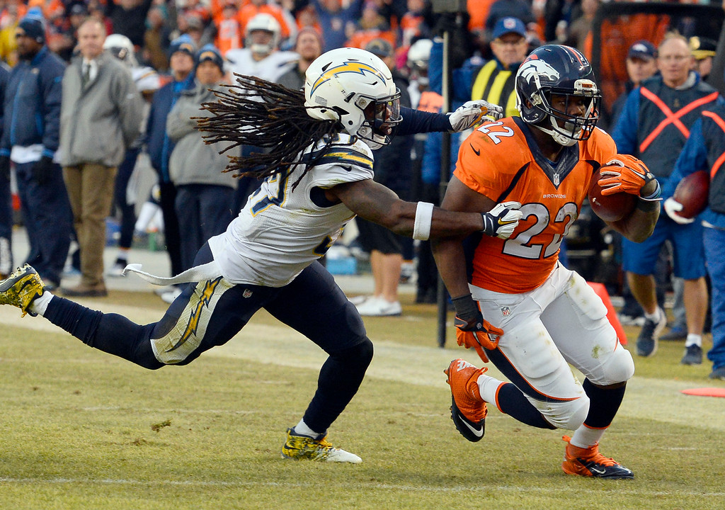 . Denver Broncos running back C.J. Anderson (22) picks up a big gain after getting tackled by San Diego Chargers strong safety Jahleel Addae (37) down at the 6 yard line during the third quarter January 3, 2016 at Sports Authority Field at Mile High Stadium. (Photo By Helen Richardson/The Denver Post)
