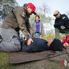 Team Rubicon photographer Jonathen E. Davis, left, checks Tim Tran's breathing during a head-to-toe assessment. Team Rubicon members from Region 9 participated in a three-day Wilderness First Aid/First Responder training at Beals Point in Folsom, Cali. The training taught TR members about providing aid when they come those who sustained injuries.