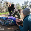 Team Rubicon member Jonathan Walker, top, performs an abdominal exam on Christian Velasquez while Lisa Swank supports his head during a head-to-toe examination. Team Rubicon members from Region 9 participated in a three-day Wilderness First Aid/First Responder training at Beals Point in Folsom, Cali. The training taught TR members about providing aid when they come those who sustained injuries.