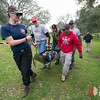 Team Rubicon members work together to move a simulated injured victim while strapped into a portable stretcher and spinal brace. Team Rubicon members from Region 9 participated in a three-day Wilderness First Aid/First Responder training at Beals Point in Folsom, Cali. The training taught TR members about providing aid when they come those who sustained injuries.