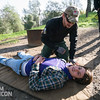 Team Rubicon member Christian Velasquez, bottom, acts as an unruly camper as Jonathan Walker tries to help him. Team Rubicon members from Region 9 participated in a three-day Wilderness First Aid/First Responder training at Beals Point in Folsom, Cali. The training taught TR members about providing aid when they come those who sustained injuries.