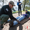 Team Rubicon member Jonathan Walker, left,  performs a head-to-toe assessment on Christian Velasquez while Lisa Swank supports his head. Team Rubicon members from Region 9 participated in a three-day Wilderness First Aid/First Responder training at Beals Point in Folsom, Cali. The training taught TR members about providing aid when they come those who sustained injuries.