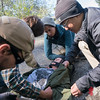 Team Rubicon members work together to provide medical aid to a simulated injured victim. Team Rubicon members from Region 9 participated in a three-day Wilderness First Aid/First Responder training at Beals Point in Folsom, Cali. The training taught TR members about providing aid when they come those who sustained injuries.