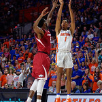 Univeristy of Florida Gators forward Devin Robinson hits a three point shot during the second half as the Gators celebrate senior day defeating the University of Arkansas Razorbacks 78-65 in Exactech Arena at the Stephen C. O'Connell Center in Gainesville, Florida.  March 1st, 2017. Gator Country photo by David Bowie.