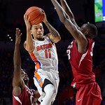 Univeristy of Florida Gators guard Chris Chiozza driving to the basket during the second half as the Gators celebrate senior day defeating the University of Arkansas Razorbacks 78-65 in Exactech Arena at the Stephen C. O'Connell Center in Gainesville, Florida.  March 1st, 2017. Gator Country photo by David Bowie.