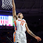 Univeristy of Florida Gators guard Chris Chiozza flies through the air and scores during the first half as the Gators celebrate senior day defeating the University of Arkansas Razorbacks 78-65 in Exactech Arena at the Stephen C. O'Connell Center in Gainesville, Florida.  March 1st, 2017. Gator Country photo by David Bowie.
