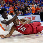 Univeristy of Florida Gators center Gorjok Gak dives trying to save the ball during the first half as the Gators celebrate senior day defeating the University of Arkansas Razorbacks 78-65 in Exactech Arena at the Stephen C. O'Connell Center in Gainesville, Florida.  March 1st, 2017. Gator Country photo by David Bowie.
