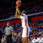 Univeristy of Florida Gators forward Justin Leon drains a three pointer during the first half as the Gators celebrate senior day defeating the University of Arkansas Razorbacks 78-65 in Exactech Arena at the Stephen C. O'Connell Center in Gainesville, Florida.  March 1st, 2017. Gator Country photo by David Bowie.