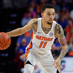 Univeristy of Florida Gators guard Chris Chiozza dribbling up court during the second half as the Gators celebrate senior day defeating the University of Arkansas Razorbacks 78-65 in Exactech Arena at the Stephen C. O'Connell Center in Gainesville, Florida.  March 1st, 2017. Gator Country photo by David Bowie.