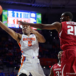 Univeristy of Florida Gators guard KeVaughn Allen lays the ball into the basket during the first half as the Gators celebrate senior day defeating the University of Arkansas Razorbacks 78-65 in Exactech Arena at the Stephen C. O'Connell Center in Gainesville, Florida.  March 1st, 2017. Gator Country photo by David Bowie.