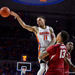 Univeristy of Florida Gators guard Chris Chiozza passes the ball off during the second half as the Gators celebrate senior day defeating the University of Arkansas Razorbacks 78-65 in Exactech Arena at the Stephen C. O'Connell Center in Gainesville, Florida.  March 1st, 2017. Gator Country photo by David Bowie.