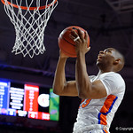 Univeristy of Florida Gators forward Justin Leon driving to the basket and scoring during the first half as the Gators celebrate senior day defeating the University of Arkansas Razorbacks 78-65 in Exactech Arena at the Stephen C. O'Connell Center in Gainesville, Florida.  March 1st, 2017. Gator Country photo by David Bowie.