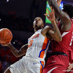 Univeristy of Florida Gators guard Kasey Hill flies through the air and scores during the first half as the Gators celebrate senior day defeating the University of Arkansas Razorbacks 78-65 in Exactech Arena at the Stephen C. O'Connell Center in Gainesville, Florida.  March 1st, 2017. Gator Country photo by David Bowie.