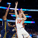 Univeristy of Florida Gators guard Canyon Barry leaping for a rebound during the first half as the Gators advance to the second round of 2017 NCAA Tournament with a win over the  East Tennessee State Buccaneers 80-65.  March 16th, 2017.  Gator Country photo by David Bowie.