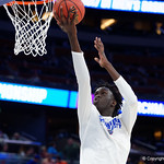 Univeristy of Florida Gators center Gorjok Gak shooting during pre-game warmups as the Gators advance to the second round of 2017 NCAA Tournament with a win over the  East Tennessee State Buccaneers 80-65.  March 16th, 2017.  Gator Country photo by David Bowie.