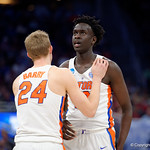 Univeristy of Florida Gators center Gorjok Gak and Univeristy of Florida Gators guard Canyon Barry during the first half as the Gators advance to the second round of 2017 NCAA Tournament with a win over the  East Tennessee State Buccaneers 80-65.  March 16th, 2017.  Gator Country photo by David Bowie.