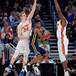 Univeristy of Florida Gators guard Canyon Barry leaps on defense of East Tennessee State University Buccaneers guard Jermaine Long during the second half as the Gators advance to the second round of 2017 NCAA Tournament with a win over the  East Tennessee State Buccaneers 80-65.  March 16th, 2017.  Gator Country photo by David Bowie.