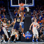 Univeristy of Florida Gators forward Devin Robinson blocks a shot by East Tennessee State University Buccaneers forward Tevin Glass during the second half as the Gators advance to the second round of 2017 NCAA Tournament with a win over the  East Tennessee State Buccaneers 80-65.  March 16th, 2017.  Gator Country photo by David Bowie.