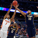 Univeristy of Florida Gators forward Devin Robinson leaps for a rebound against East Tennessee State University Buccaneers forward Isaac Banks during the second half as the Gators advance to the second round of 2017 NCAA Tournament with a win over the  East Tennessee State Buccaneers 80-65.  March 16th, 2017.  Gator Country photo by David Bowie.