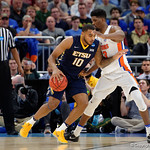 Univeristy of Florida Gators forward Kevarrius Hayes defending East Tennessee State University Buccaneers forward Isaac Banks during the first half as the Gators advance to the second round of 2017 NCAA Tournament with a win over the  East Tennessee State Buccaneers 80-65.  March 16th, 2017.  Gator Country photo by David Bowie.