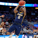 East Tennessee State University Buccaneers guard T.J. Cromer drives to the basket and scores during the first half as the Gators advance to the second round of 2017 NCAA Tournament with a win over the  East Tennessee State Buccaneers 80-65.  March 16th, 2017.  Gator Country photo by David Bowie.