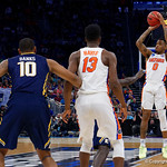 Univeristy of Florida Gators guard Kasey Hill drains a three pointer during the first half as the Gators advance to the second round of 2017 NCAA Tournament with a win over the  East Tennessee State Buccaneers 80-65.  March 16th, 2017.  Gator Country photo by David Bowie.