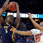 Univeristy of Florida Gators forward Justin Leon leaping for a rebound against East Tennessee State University Buccaneers forward Hanner Mosquera-Perea during the second half as the Gators advance to the second round of 2017 NCAA Tournament with a win over the  East Tennessee State Buccaneers 80-65.  March 16th, 2017.  Gator Country photo by David Bowie.