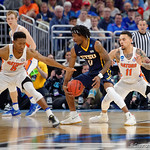 Univeristy of Florida Gators guard Chris Chiozza and Univeristy of Florida Gators guard KeVaughn Allen defending East Tennessee State University Buccaneers guard T.J. Cromer during the second half as the Gators advance to the second round of 2017 NCAA Tournament with a win over the  East Tennessee State Buccaneers 80-65.  March 16th, 2017.  Gator Country photo by David Bowie.