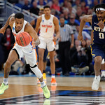 Univeristy of Florida Gators guard Kasey Hill sprints for a loose ball during the first half as the Gators advance to the second round of 2017 NCAA Tournament with a win over the  East Tennessee State Buccaneers 80-65.  March 16th, 2017.  Gator Country photo by David Bowie.