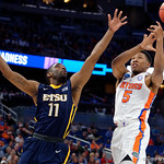 Univeristy of Florida Gators guard KeVaughn Allen has the ball rejected by East Tennessee State University Buccaneers guard Desonta Bradford during the second half as the Gators advance to the second round of 2017 NCAA Tournament with a win over the  East Tennessee State Buccaneers 80-65.  March 16th, 2017.  Gator Country photo by David Bowie.